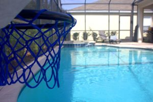 There's a pool-side basketball hoop