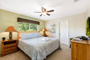 The second floor king bedroom features a King Sized Memory Foam Pillow Top Mattress,Ceiling Fan, Wall Mounted 40 inch HD LED TV with Internet Apps, Blu-ray Player, Barrel Accent Chair and a Huge Walk-in Closet