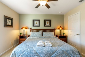 The King Bedroom features a king sized pillow top mattress, ceiling fan, 32 inch HD TV with Internet Apps, Blu-ray player, accent chair and an en suite with walk-in shower