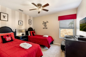 The Mickey room features two twin beds, a ceiling fan, 32 inch HD LED TV with internet apps, Blu-ray player, a chair that converts to an extra twin bed, Sony PS2 and large double door closets.