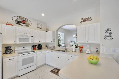 The Kitchen in this Top Rated 6 bedroom HomeAway Windsor Hills Vacation Rental By Owner In Florida